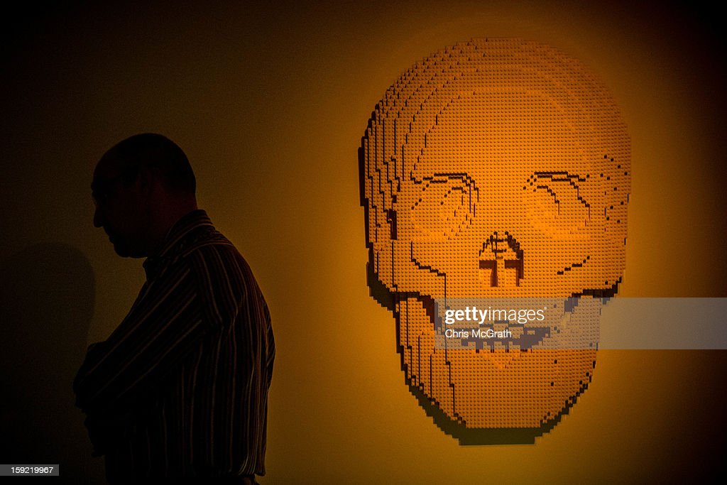 A man views a sculpture made out of Lego at the 'The Art of the Brick' exhibition on January 9, 2013 at the ArtScience Museum in Singapore. The exhibition by renowned New York based brick artist Nathan Sawaya features 52 large-scale LEGO brick sculptures and showcases two of the artists iconic pieces 'Yellow' and 'Swimmer'. It is the first time his work has been exhibited in South East Asia. The exhibit runs from 17 Nov 2012 to 14 April 2013.
