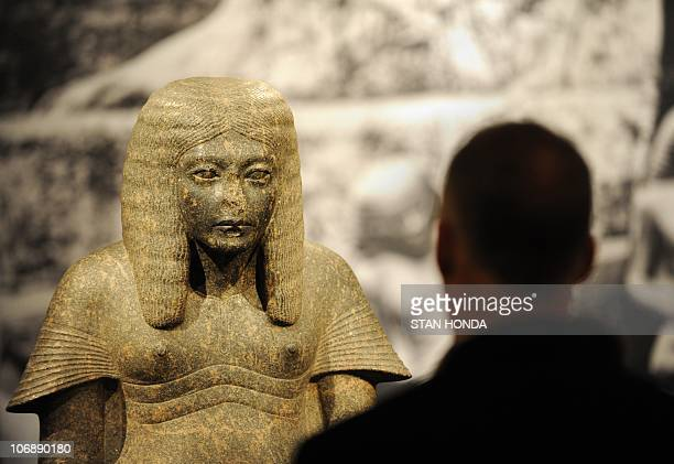 A man views a stone statue 'Haremhab as a Scribe' New Kingdom Dynasty 18 reign of Tutankhamun or Aya ca 1328�1316 BC on display Novermber 15 2010 in...