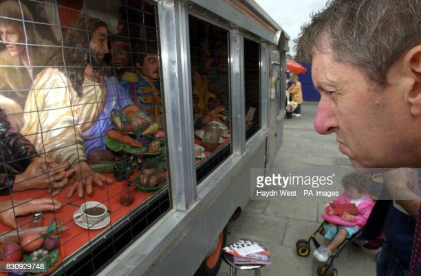 A man views a work of art titled 'The Diner' by Texan artist Greg Metz on show in the middle of O'Connell Street in Dublin City centre the Republic...