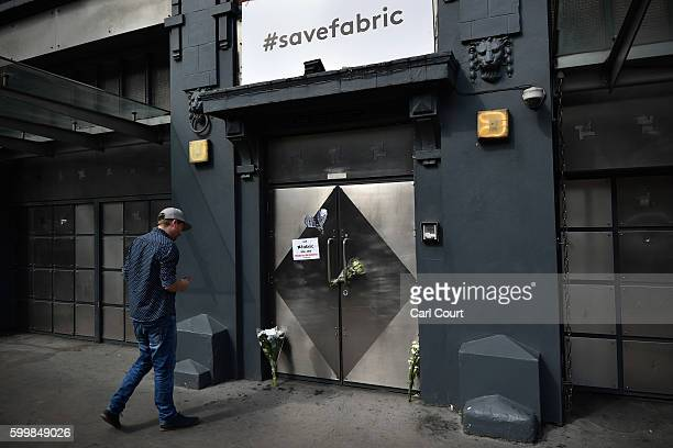 A man views flowers and messages outside Fabric nightclub following the announcement of its closure on September 7 2016 in London England Fabric...