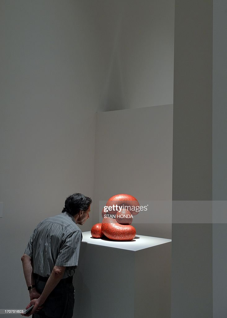 A man views 'Little D, 2011' by artist Ken Price during a preview of 'Ken Price Sculpture: A Retrospective' June 17, 2003 at the Metropolitan Museum of Art in New York. AFP PHOTO/Stan HONDA