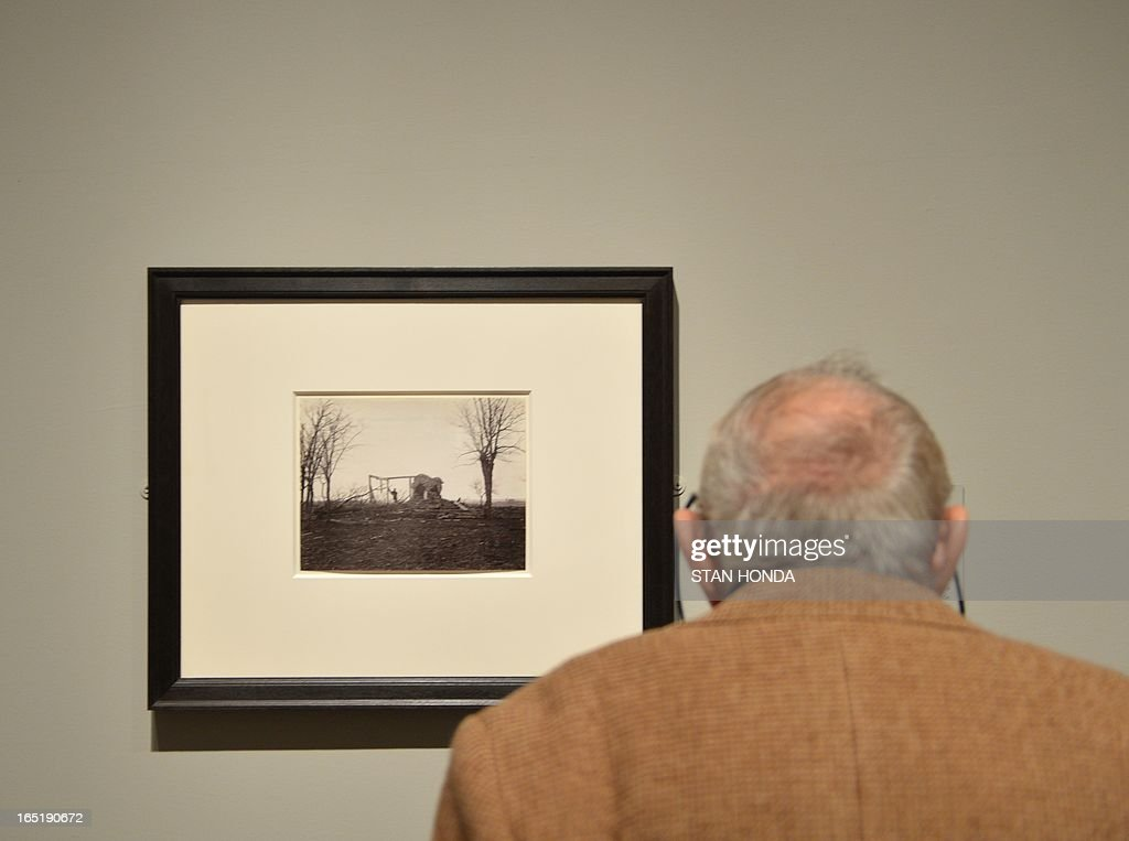A man views 'Ruins of Mrs. Henry's House, Battlefield of Bull Run, March 1862', albumen silver print from glass negative by George N. Barnard in the exhibition, 'Photography and the American Civil War' April 1, 2013 at The Metropolitan Museum of Art in New York. AFP PHOTO/Stan HONDA