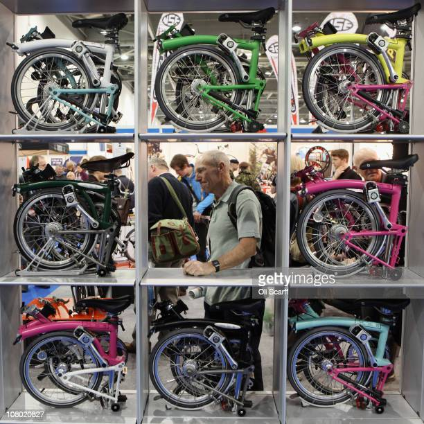 A man views the Brompton folding bikes on display at the London Bike Show at the ExCeL centre on January 13 2011 in London England The bicycle trade...