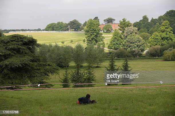 A man views The Grove hotel which is hosting the annual Bilderberg conference from the designated protest and media zone on June 6 2013 in Watford...