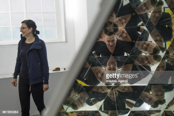 A man views the Kaleidoscope installation an exhibition part of the Museum of Illusions in Vienna Austria on October 16 2017 The Museum of Illusions...