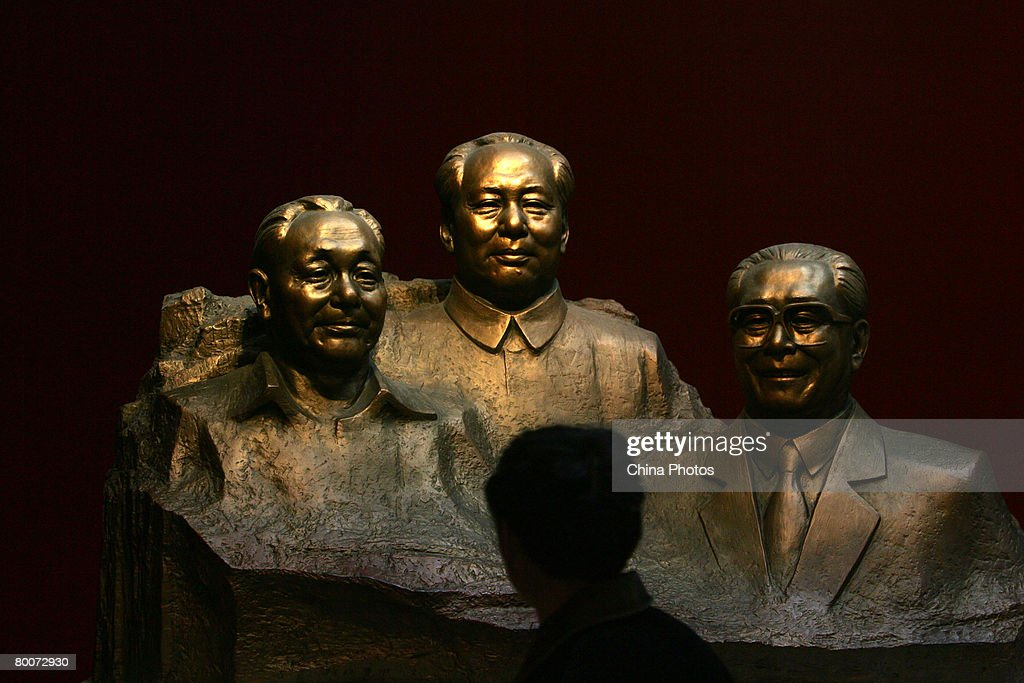 A man views the sculptures of former Chinese leader (L-R) Deng Xiaoping, Mao Zedong and Jiang Zemin, at the Military Museum of Chinese People's Revolution on March 1, 2008 in Beijing, China. From March 1, the Military Museum of Chinese People's Revolution becomes the first national level museum which opens to the public for free in Beijing.