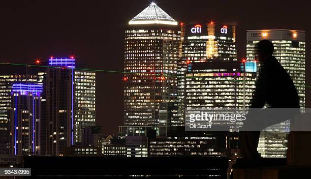 A man views the skyscrapers in Canary Wharf on November 26 2009 in London England Former banker Sir David Walker has published his report...