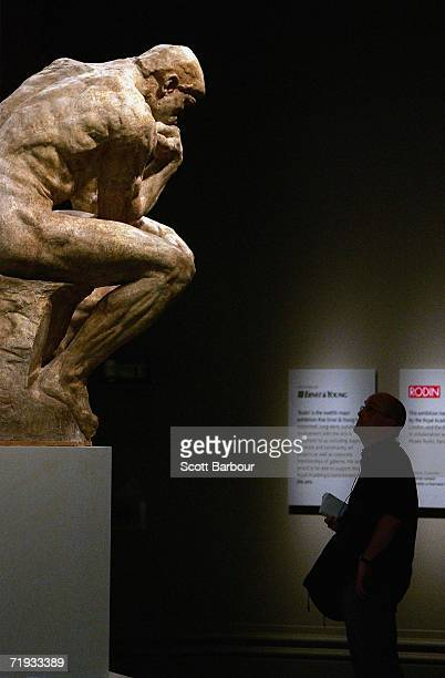 A man views 'The Thinker' by French sculptor Auguste Rodin during the press launch of the Rodin exhibition at the Royal Academy of Arts on September...