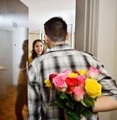 Man visiting his girlfriend bringing flowers.