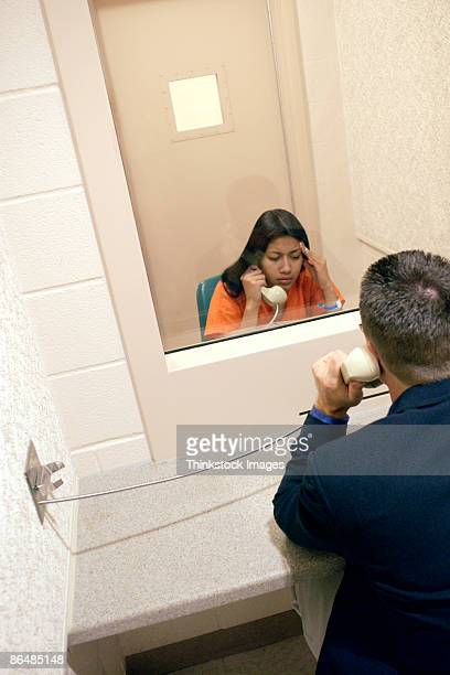 Man visiting woman in prison