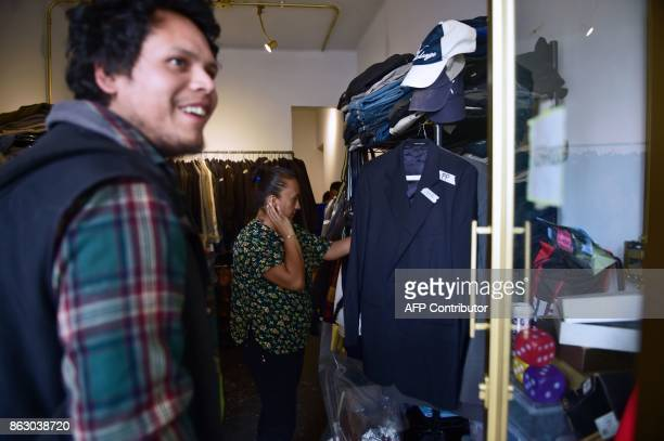 A man visits a 'boutique' that gives away donated crisp business clothes to those who on Mexico's September 19 quake lost everything but their jobs...