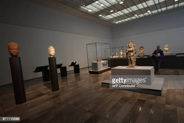 A man visits a gallery at the Louvre Abu Dhabi Museum during a media tour on November 6 2017 prior to the official opening of the museum on Saadiyat...