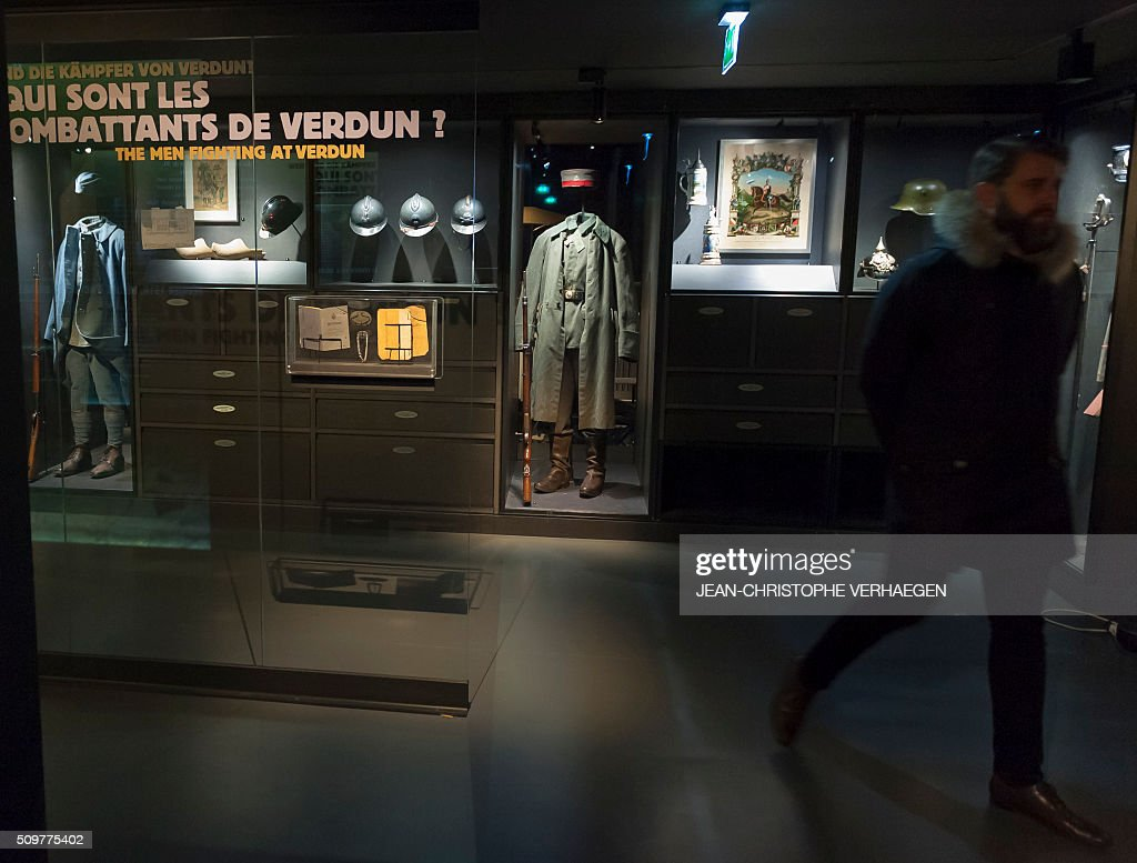 A man visits as he looks at soldiers belongings and equipment displayed for the exhibition that commemorate the 1916 Battle of Verdun in the redesigned Memorial of Verdun in Fleury-devant-Douaumont, on February 12, 2106. The memorial will reopen on February 22, 2016. VERHAEGEN
