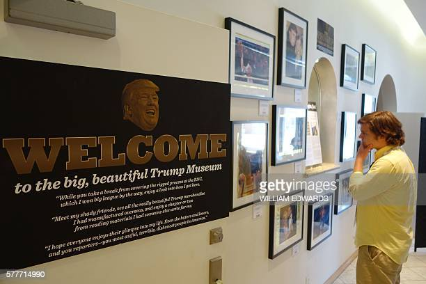 A man visits exhibits at a socalled Trump Museum in Cleveland on July 19 2016 Democratic Super PAC American Bridge organisation has set up to...
