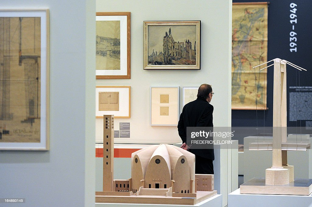 A man visits on March 27, 2013 the exhibition ' Interferences / Interferenzen' at the Museum of Modern and Contemporary Art of Strasbourg, eastern France. This exhibition of architecture, art and history, provides an unprecedented overview of architectural and urban interactions between France and Germany from the aftermath of the French Revolution and the Napoleonic era to the present day.