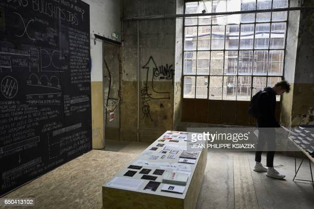 A man visits the 10th SaintEtienne International Design Biennial on March 9 2017 at the SaintEtienne Cite du Design site formerly the Arms...
