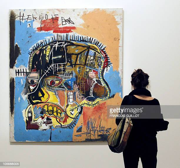 A man visits the American painter JeanMichel Basquiat's exhibition on October 19 2010 at the Modern Arts museum in Paris This exhibition will be held...