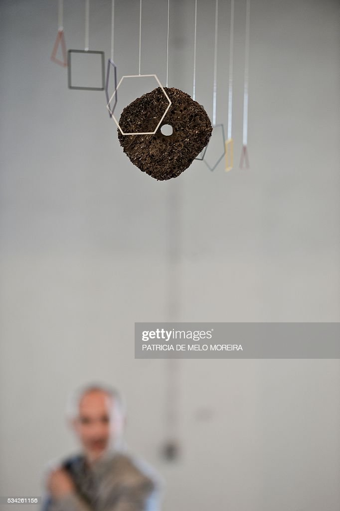 A man visits the Brazilian gallery 'Luisa Strina' stand during the ARCO Lisbon Contemporary Art Fair in Lisbon on May 25, 2016. ARCO will be open to the public from May 26 to 29. / AFP / PATRICIA