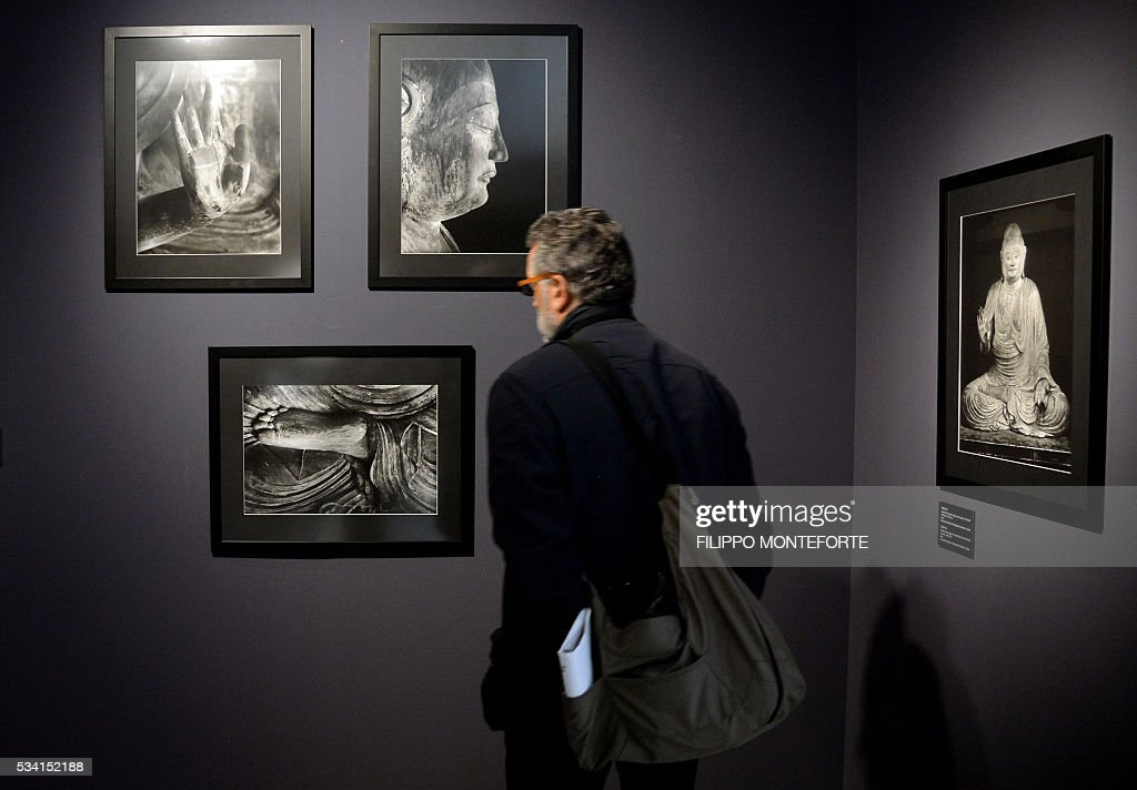 A man visits the exhibition of Japanese photographer Domon Ken (1909-1990) during a press preview at the Ara Pacis Museum (Museo dell'Ara Pacis) on May 25, 2016 in Rome. The show will run from May 27, 2016 to September 18, 2016 to mark 150th years of friendship between Japan and Italy. / AFP / FILIPPO