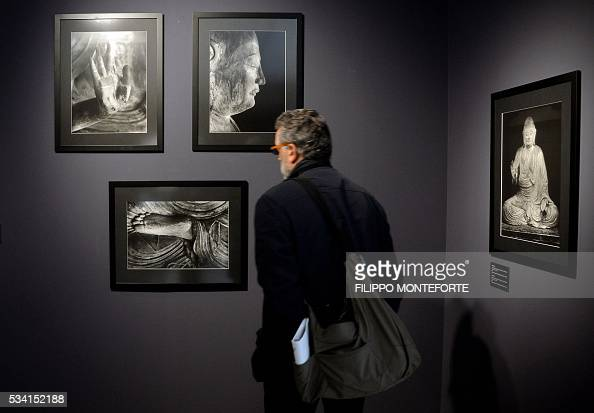 A man visits the exhibition of japanese photographer domon for Domon ken museum