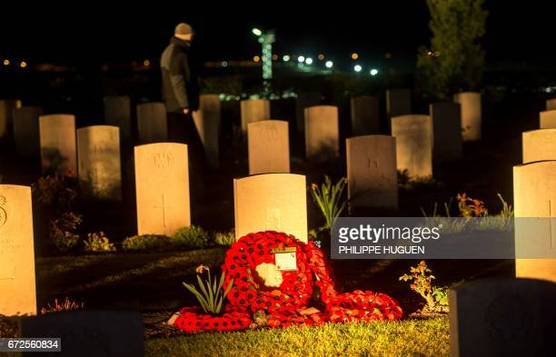 A man visits the military cemetery of the Australian National Memorial in VillersBretonneux northern FRance on April 25 during Anzac Day marking 101...