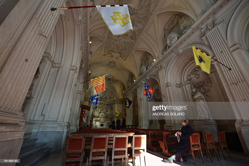 A man visits the Santa Maria del Priorato Church at the 'Villa Magistrale', the historical site of the Order of Malta Knights, on February 10, 2013 in Rome. The historical site of the Villa of the Priory, is open to the public to celebrate the 900th anniversary of the Order of the Knigths of Malta.