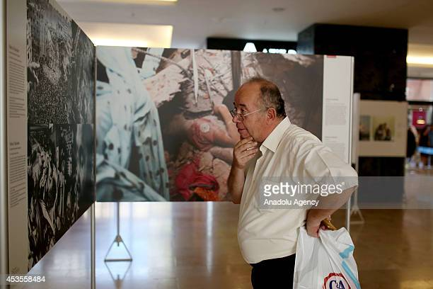 A man visits the World Press Photo 2014 exhibition displaying award winning snapshots of photojournalists from around the world at Forum Istanbul...