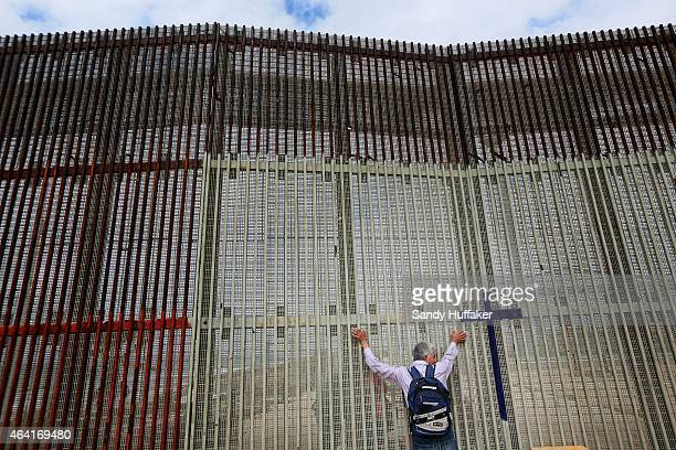 A man visits with Family members through the border fence along the USMexico border on February 22 2015 in Tijuana Mexico Senior Republican senators...