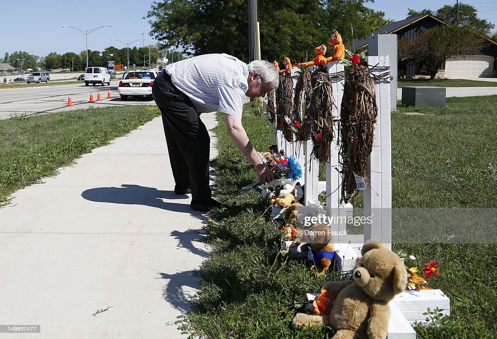 A man vists the makeshift memorial near the Sikh Temple of Wisconsin August, 7, 2012 Oak Creek Wisconsin. A suspected gunman, 40-year-old Wade Michael Page, allegedly killed six people at the temple August 5, was shot to death by police at the scene. He was an army veteran and reportedly a former leader of a white supremacist heavy metal band. Three others were critically wounded in the attack.
