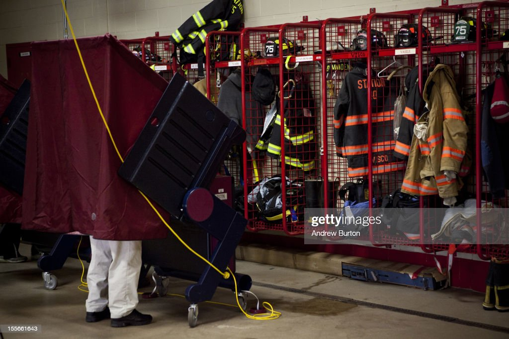A man votes at the Point Pleasant Fire House on November 6, 2012 in Point Pleasant, New Jersey. As the New Jersey coastline continues to recover from Superstorm Sandy, numerous polling stations have had to be merged and relocated due to storm damage and power outages.