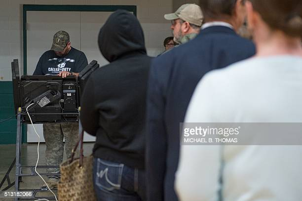 A man votes at the polls at the McGee Community Center on March 1 2016 in Conway Arkansas Americans began voting in the crucial Super Tuesday...