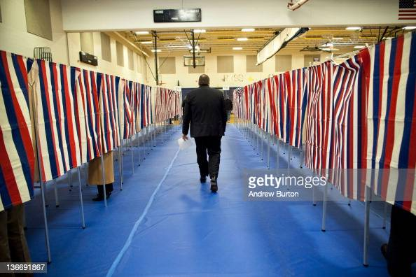 A man votes in the New Hampshire primary at Bedford High School on January 10 2012 in Bedford New Hampshire Voters in New Hampshire headed to the...