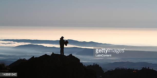 A man wait for the cars during the 32 edition of rally Argentina at Cordoba´s mountains El Condor Copina on April 29 2012 in Cordoba Argentina