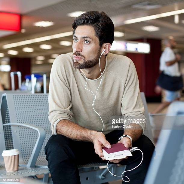 man waiting at airport