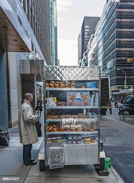 Man waiting at coffee vendor's cart on Madison Avenue