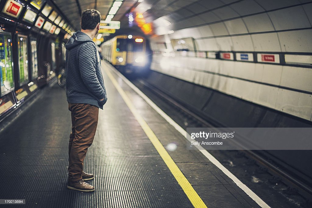 Man waiting for a train : Stock Photo