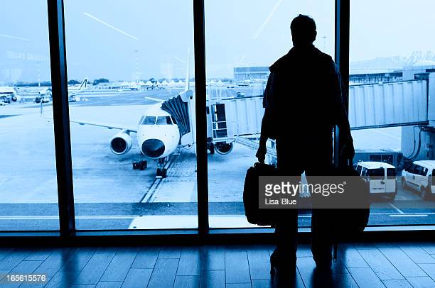 Man Waiting for Flight in Airport Lounge
