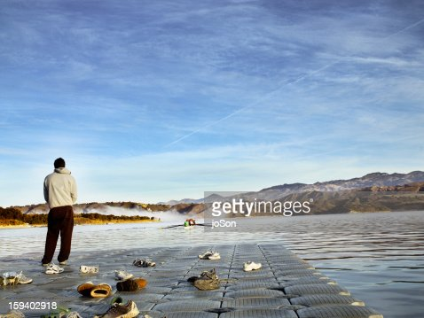 man waiting for rowing in the distance : Stock Photo
