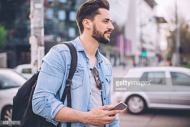 Man waiting for Uber in the street
