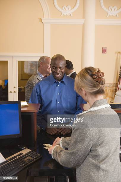 Man waiting in line at bank