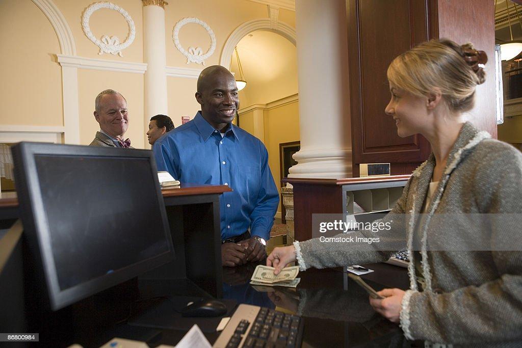 Man waiting in line for bank teller
