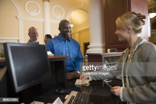 Man waiting in line for bank teller