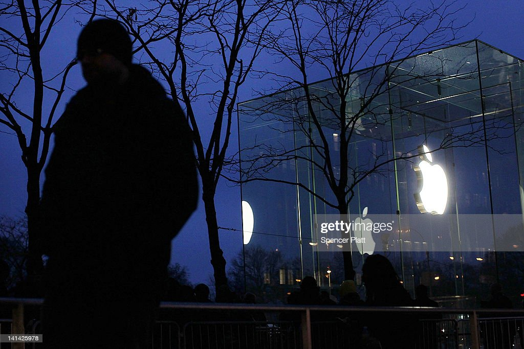 A man waits at dawn with hundreds of others in line to purchase the new iPad which went on sale around on March 16, 2012 in New York City. Simply called the iPad, the new tablet replaces the iPad 2 and features a high-pixel-count 'retina display'. Hundreds of people waited in line all night to be the first in the flagship Apple Store on Manhattan's Fifth Avenue.