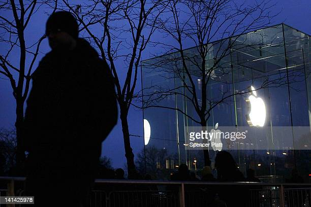 A man waits at dawn with hundreds of others in line to purchase the new iPad which went on sale around on March 16 2012 in New York City Simply...