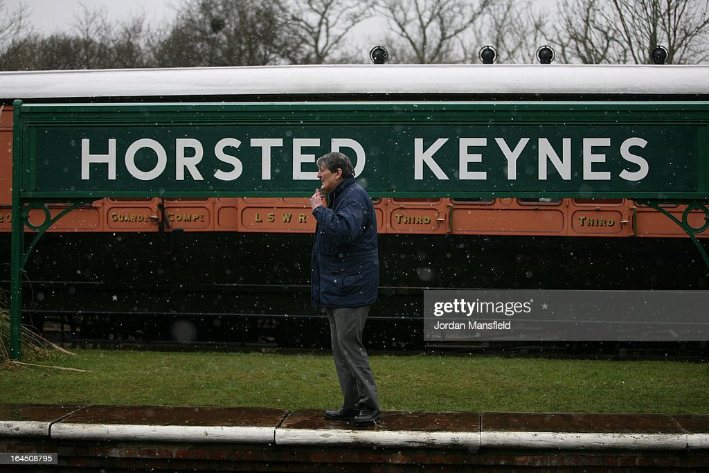 A man waits at Horsted Keynes station on March 23, 2013 in Horsted Keynes, England.. The Bluebell Railway ran its first steam train this weekend on the reclaimed line from Kingscote to East Grinstead after volunteers from the Bluebell Society worked to reopen the line after its closure on March 17, 1958. 50 years on from Dr. Richard Beeching's report signaling the widespread closure of rural rail routes across the UK, Britain's railways are in great demand with old lines reopening and pressure on to restore rural lines that were closed.