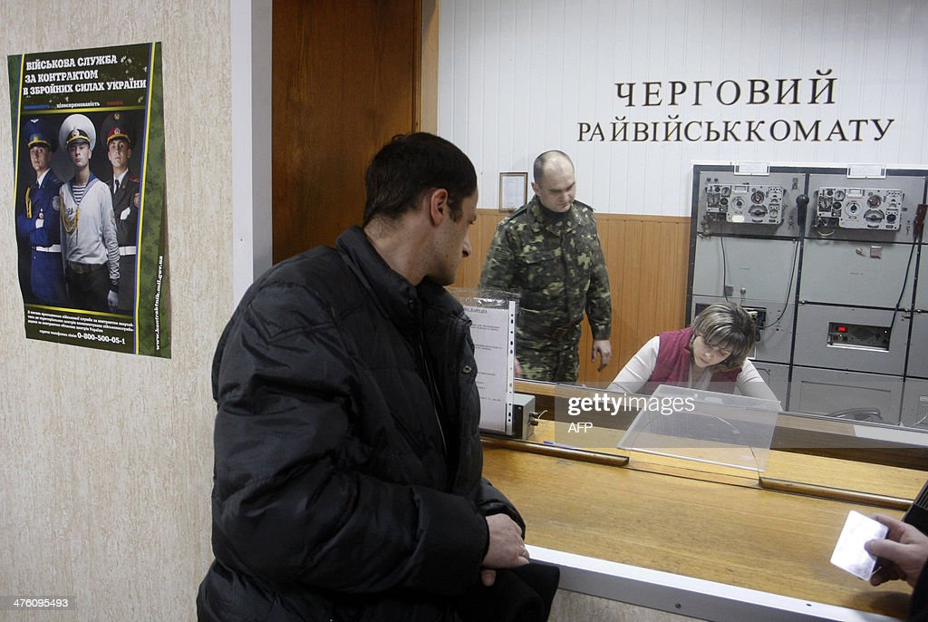 A man waits at the reception of a military enlistment office in Kiev, on March 2, 2014. Ukraine is to call up all military reservists, the head of the national security and defence council said Sunday, after Russia's parliament approved the deployment of troops in the country. Ukraine warned Sunday it was on the brink of disaster after Russia's threat to invade its neighbour drew sharp rebukes from the United States and NATO.