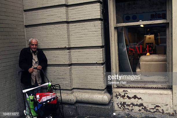 A man waits for a bus next to a retail store on September 28 2010 in the Brooklyn borough of New York City A new report released by the US Census...