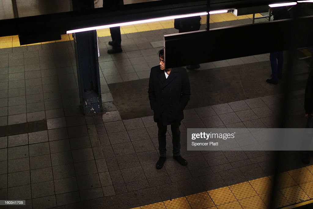 A man waits for a subway at a Manhattan station on January 29, 2013 in New York City. The city has been experiencing a rash of high-profile incidents involving individuals being hit by trains in suicides, accidents and people being pushed to their deaths. Lawmakers are planning to discuss the recent deaths while also seeking ideas for more safety on the tracks. The New York City subway system, with 468 stations in operation, is the most extensive public transportation system in the world. It is also one of the world's oldest public transit systems, with the first underground line of the subway opening on October 27, 1904.