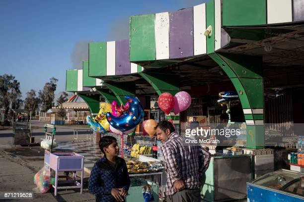 A man waits for customers at the Mosul Amusement Park on November 4 2017 in Mosul Iraq The theme park was shut down under ISIS occupation and the...
