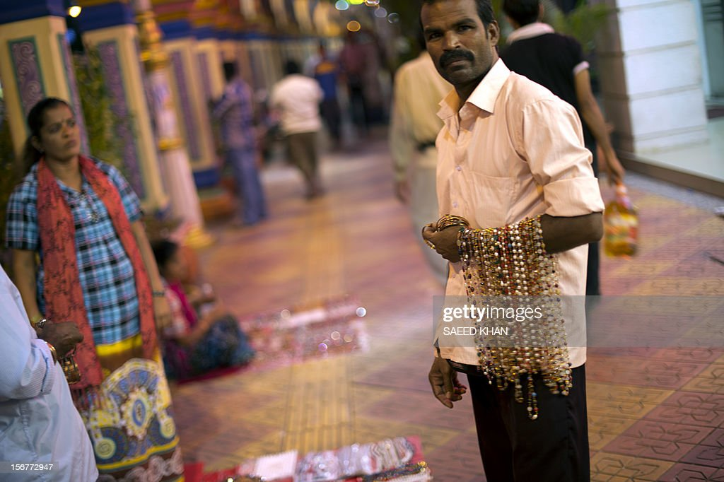 A man waits for customers to sell his hand-made jewelry in the Brickfields area, also known as Little India, in Kuala Lumpur on November 20, 2012. Malaysia's economy grew a better-than-expected 5.2 percent in the third quarter as domestic demand continued to compensate for a slowdown in exports, the government said recently. AFP PHOTO / Saeed KHAN